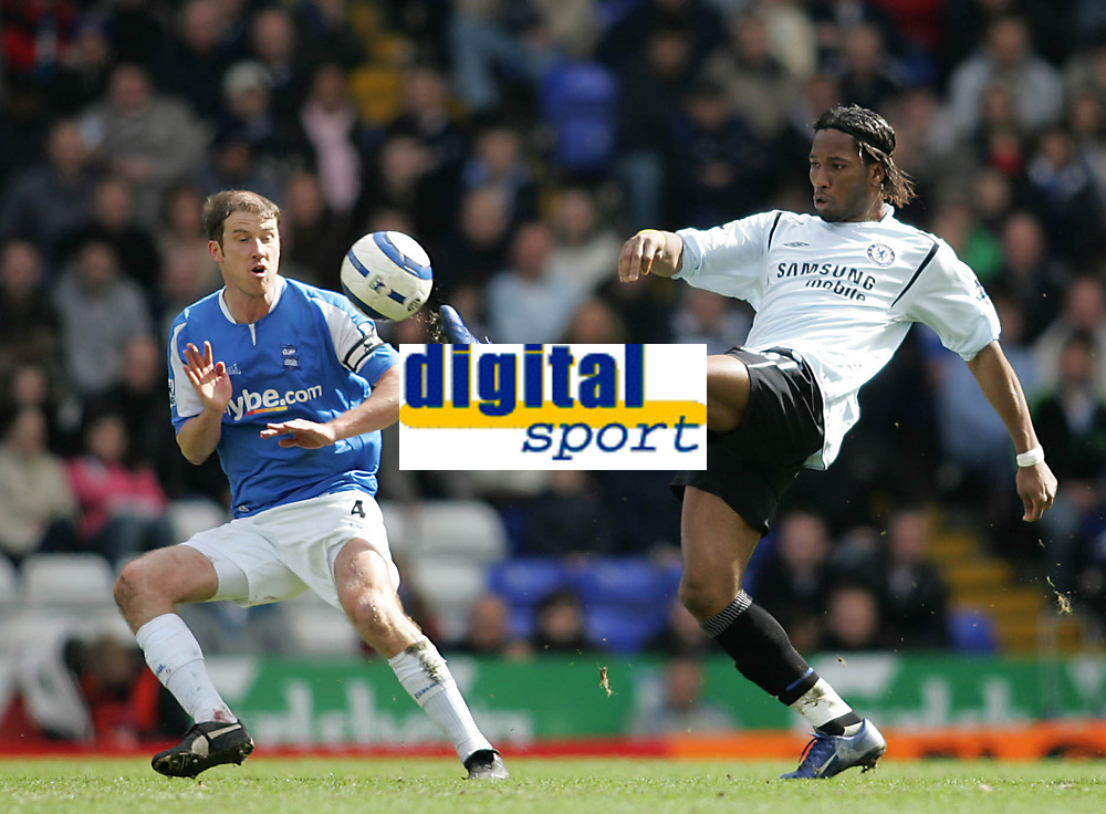 Photo: Lee Earle.<br /> Birmingham City v Chelsea. The Barclays Premiership. 01/04/2006. City's Kenny Cunningham (L) watches as Didier Drogba clears.