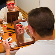 VENICE, ITALY - JULY 29:  Li Hongliang of the Kunqu Opera of Jiangsu put stage make up ahead of the performance  at Teatro Goldoni on July 29, 2011 in Venice, Italy. Kunqu Opera, now under the Unesco patronage, originated in the Jiangsu province, dating back to the early Ming dinasty. With a history of more than six hundred years, Kunqu Opera is a traditional type of Chinese drama and one of the most ancient opera forms in China and in the world.