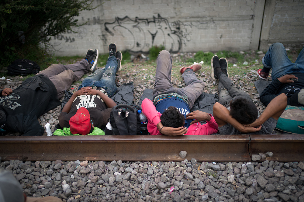 Honduran migrants resting outside the migrant refuge in Apizaco, Mexico.