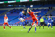 Cardiff City's Harry Wilson (23) competes for a high ball with Millwall's Ben Thompson (8) during the EFL Sky Bet Championship match between Cardiff City and Millwall at the Cardiff City Stadium, Cardiff, Wales on 30 January 2021.