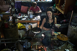 An activist prepares to eat food prepared on the camp fire at the Stop HS2 Wendover Active Resistance Camp on 17th July 2020 in Wendover, United Kingdom. Environmental activists from groups including Stop HS2 and HS2 Rebellion continue to protest against HS2, which is currently projected to cost £106bn and which will remain a net contributor to CO2 emissions during its projected 120-year lifespan, on environmental and economic grounds.
