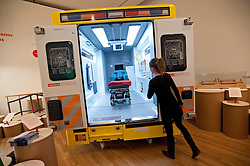 © Licensed to London News Pictures. 07/02/2012. A Design Museum worker poses next t a New Ambulance Design, which incorporates enough space for a paramedic to have 360-degree access to the patient,  on display at Design of the Year  2012, at the Design Museum in London on February 7th, 2012. The awards showcase the most innovative designs from around the world, covering seven categories: architecture, fashion, furniture, graphics, interactive, product and transport. Photo credit : Ben Cawthra/LNP