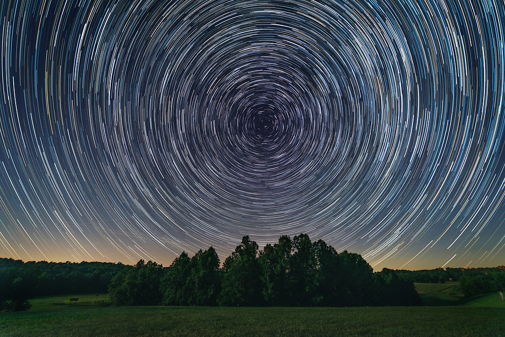 Star trails swirl around Polaris, the North Star, in this hour-long exposure at Calhoun County Park outside of Grantsville, West Virginia;