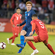 EAST HARTFORD, CONNECTICUT- October 16th:    Josh Sargent #13 of the United States defended by defenseman Alexander Callens #5 of Peru during the United States Vs Peru International Friendly soccer match at Pratt & Whitney Stadium, Rentschler Field on October 16th 2018 in East Hartford, Connecticut. (Photo by Tim Clayton/Corbis via Getty Images)