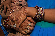 Rajasthani wedding guest with henna painted hands. Pushkar, Rajasthan. INDIA