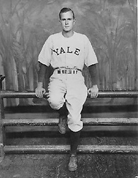"""George H. W. Bush standing in front of a """"Yale Fence"""" in his baseball uniform at Yale University, circa 1945-48. Photo by George Bush Presidential Library/MCT/ABACAPRESS.COM"""