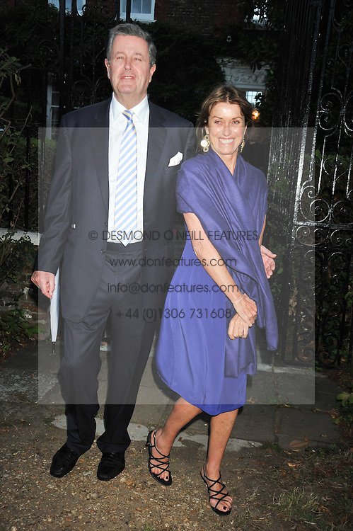 LORD CHARLES SPENCER-CHURCHILL and CHARLOTTE SCOTT at a Summer party hosted by Lady Annabel Goldsmith at her home Ormeley Lodge, Ham, Surrey on 14th July 2009.