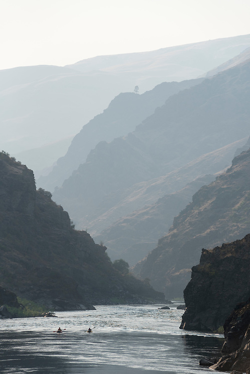 Paddling inflatable kayaks down the canyon of the lower Salmon River in Idaho.