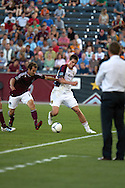 August 4, 2012:Colorado Rapids midfielder Brian Mullan (11) tries to take the ball away from Real Salt Lake forward Justin Braun (13) in the first half at Dick's Sporting Goods Park in Denver, Colorado