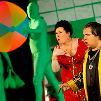 Picture shows : Karen Cargill as Isabella and Tiziano Bracci as Mustafa. Picture  ©  Drew Farrell Tel : 07721 -735041..A new Scottish Opera production of  Rossini's 'The Italian Girl in Algiers' opens at The Theatre Royal Glasgow on Wednesday 21st October 2009..(Soap) opera as you've never seen it before..Tonight on Algiers.....Colin McColl's cheeky take on Rossini's comic opera is a riot of bunny girls, beach balls, and small screen heroes with big screen egos. Set in a TV studio during the filming of popular Latino soap, Algiers, the show pits Rossini's typically playful and lyrical music against the shoreline shenanigans of cast and crew. You'd think the scandal would be confined to the outrageous storylines, but there's as much action off set as there is on.....Italian bass Tiziano Bracci makes his UK debut in the role of Mustafa. Scottish mezzo-soprano Karen Cargill, who the Guardian called a 'bright star' for her performance as Rosina in Scottish Opera's 2007 production of The Barber of Seville, sings Isabella..Cast .Mustafa...Tiziano Bracci.Isabella..Karen Cargill.Lindoro...Thomas Walker.Elvira...Mary O'Sullivan.Zulma...Julia Riley.Haly...Paul Carey Jones.Taddeo...Adrian Powter..Conductors.Wyn Davies.Derek Clarke (Nov 14)..Director by Colin McColl.Set and Lighting Designer by Tony Rabbit.Costume Designer by Nic Smillie..New co-production with New Zealand Opera.Production supported by.The Scottish Opera Syndicate.Sung in Italian with English supertitles..Performances.Theatre Royal, Glasgow - October 21, 25,29,31..Eden Court, Inverness - November 7. .His Majesty's Theatre, Aberdeen  - November 14..Festival Theatre,Edinburgh - November 21, 25, 27 ...Note to Editors:  This image is free to be used editorially in the promotion of Scottish Opera. Without prejudice ALL other licences without prior consent will be deemed a breach of copyright under the 1988. Copyright Design and Patents Act  and will be subject to payment or legal action, where appropriate..Furth