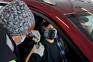 Richard Celmer, of Ironton, receives a shot of the Moderna vaccine during a COVID-19 drive-through vaccination clinic put on by Lehigh Valley Health Network on Jan. 27, 2021, at Dorney Park in Allentown, Pennsylvania. Community members 75 and older were eligible to receive their first dose with an appointment ahead of time. (Photo by Matt Smith)