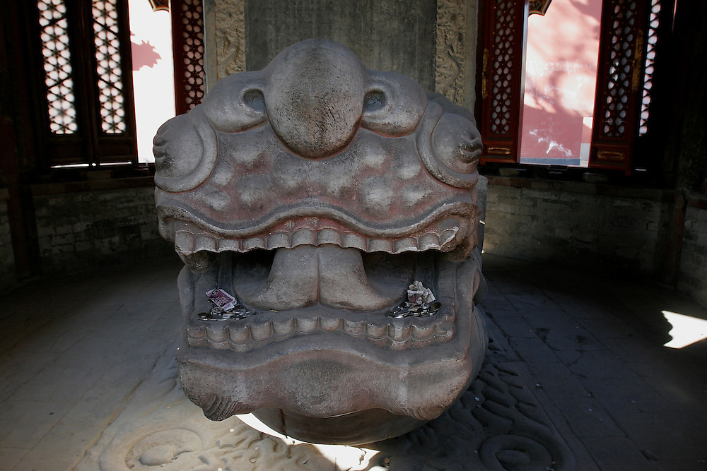 The presence of a Turtle is  good luck and this turtle statue in Yonghegong a Tibetan Buddhist Temple in northern Beijing, China is filled with money.