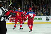 KELOWNA, BC - DECEMBER 18:  Alexander Romanov #26 and Grigory Denisenko #28 of Team Russia celebrates a goal with a teammate against the Team Sweden during the first period at Prospera Place on December 18, 2018 in Kelowna, Canada. (Photo by Marissa Baecker/Getty Images)***Local Caption***