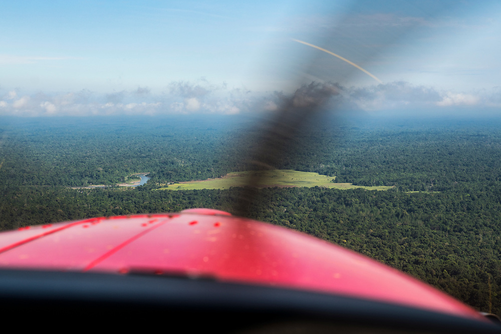 View from the cockpit of a Quest Kodiak 100 flying approaching the Clay River and village of Likan in Papua New Guinea.<br /> <br /> (June 20, 2019)