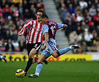 Photo: Andrew Unwin.<br />Sunderland v Aston Villa. The Barclays Premiership.<br />19/11/2005.<br />Sunderland's Dean Whitehead (L) closes in on Aston Villa's Wilfred Bouma (R).