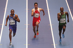 USA's Christian Coleman (left) with Malta's Jacob El Aida (centre) and st Kitts and Nevis Kim Collins (right)during day three of the 2018 IAAF Indoor World Championships at The Arena Birmingham.