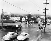 0001-E226. Powell Blvd at SE 17th, Railroad crossing, before the Powell underpass was built. Looking west down Powell toward Portland. March 13, 1955