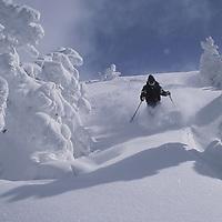 Snowcat skiing deep powder on Peaked Peak, Grand Targhee, Idaho.