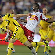 Tyson Wahl, (left), Columbus Crew, heads clear while challenged by Bradley Wright-Phillips, New York Red Bulls, during the New York Red Bulls Vs Columbus Crew, Major League Soccer regular season match at Red Bull Arena, Harrison, New Jersey. USA. 12th July 2014. Photo Tim Clayton