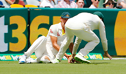 Australia's Mitchell Starc collides with Shaun Marsh during day two of the Ashes Test match at The Gabba, Brisbane.
