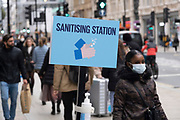 Hand sanitising station as Londoners await the imminent second coronavirus lockdown it's business as usual in the West End with large numbers of people, some wearing face masks and some not, coming to Oxford Street to go shopping on what will be the last weekend before a month-long total lockdown in the UK on 1st November 2020 in London, United Kingdom. The three tier system in the UK has not worked sufficiently, to suppress the virus, and there have have been calls by politicians for a 'circuit breaker' complete lockdown to be announced to help the growing spread of the Covid-19.
