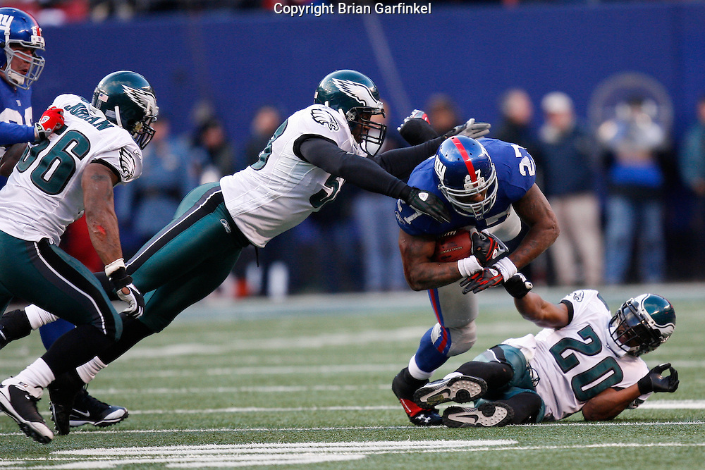 11 Jan 2009: Philadelphia Eagles defensive end Trent Cole #58 tackles New York Giants running back Brandon Jacobs #27 during the game against the New York Giants on January 11th, 2009.  The  Eagles won 23-11 at Giants Stadium in East Rutherford, New Jersey.