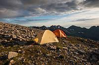 Tents on rocky summit of Støvla mountain peak, Moskenesøy, Lofoten Islands, Norway