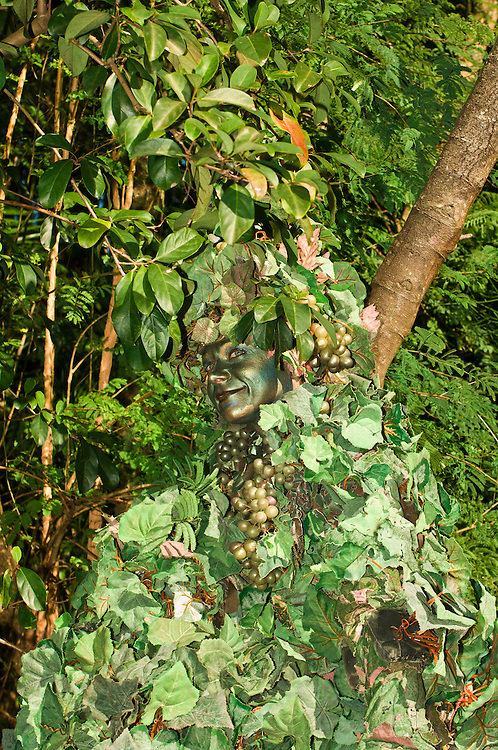 Character at Disney's Animal Kingdom in tree camouflage,  Walt Disney World, Orlando, Florida USA