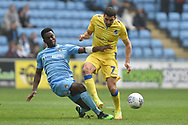Coventry City defender Brandon Mason (3) tackles Bristol Rovers midfielder Liam Sercombe (7) during the EFL Sky Bet League 1 match between Coventry City and Bristol Rovers at the Ricoh Arena, Coventry, England on 7 April 2019.