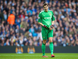 14.12.2013, Etihad Stadium, Manchester, ENG, Premier League, Manchester City vs FC Arsenal, 16. Runde, im Bild Manchester City's goalkeeper Costel Pantilimon looks dejected as Arsenal score the first equalising goal the // during the English Premier League 16th round match between Manchester City and Arsenal FC at the Etihad Stadium in Manchester, Great Britain on 2013/12/14. EXPA Pictures © 2013, PhotoCredit: EXPA/ Propagandaphoto/ David Rawcliffe<br /> <br /> *****ATTENTION - OUT of ENG, GBR*****