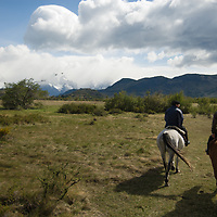 Chilean gauchos ride in Torres del Paine National Park, Patagonia, Chile.