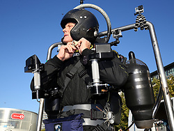 David Mayman, is strapped into the JB-10 Jetpack flying machine as he prepares for a flight around the Royal Victoria Docks in east London on its maiden flight in the UK to mark the launch of an equity crowdfunding campaign on Seedrs.