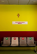 Bergamo: Opsedale Papa Giovanni XXXIII, seats are signed to keep the distance while seated. emergency room