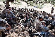 Marines relax before the days' live-fire exercises for the 2nd Battalion, 5th Marine Regiment at Camp Pendleton.