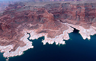 The reduced water level on Lake Powell near Padre Bay is dramatically visible from the air.