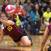 Tohatchi Cougar Delicia Begay (10) digs for the ball with a bump in the game against Rehoboth Lynx at Rehoboth Tuesday.