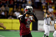 4/12/2007 - Thomas Ford, Jr. puts his helmet back on after it was knocked off by a hard Frisco hit in the Alaska Wild's 33-46 loss to the Frisco Thunder in the first professional football game in Alaska.