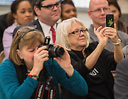 Attendees watch during a press conference for the Hour of Code at Kolter Elementary School, December 10, 2014.