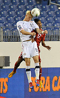 NASHVILLE, TN - MARCH 22:  Brek Shea #11 of the USA and Dayron Blanco #17 of Cuba jump for the ball in a MenÕs Olympic Qualifying match at LP Field on March 22, 2012 in Nashville, Tennessee.  (Photo by Frederick Breedon/Getty Images)