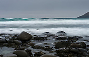Waves hitting the rocky beach at Utakleiv, Lofoten, Norway one cold winter's day in February.