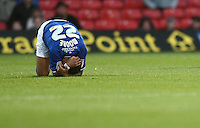 Leicester City's Liam Moore holds his head after colliding with team mate Wes Morgan ..Football - npower Football League Championship - Watford v Leicester City - Saturday 3rd November 2012 - Vicerage Road - Watford..