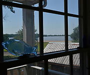 A view out the back window shows the Great River Road and the Mississippi River as seen from 10 LaSalle Street in the tiny village of Elsah, Illinois. <br /> Photo by Tim Vizer
