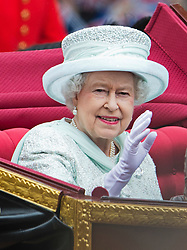 © London News Pictures. 05/06/2012. London, UK.  HM Queen Elizabeth II travels by coach  down The Mall  to Buckingham palace without Prince Philip as part of the Diamond Jubilee Carriage procession on June 5, 2012.  Photo credit: Ben Cawthra/LNP