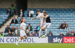 Jed Wallace of Millwall and Ezgjan Alioski of Leeds United jump for a header - Mandatory by-line: Arron Gent/JMP - 05/10/2019 - FOOTBALL - The Den - London, England - Millwall v Leeds United - Sky Bet Championship