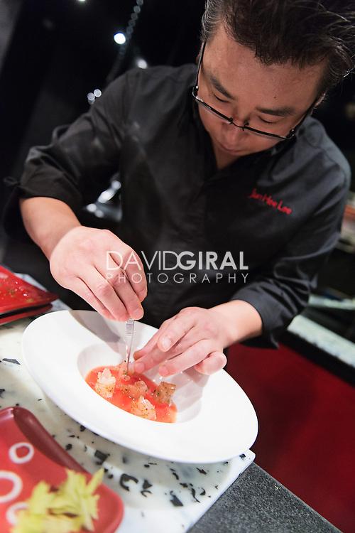 Portrait of Jun Hee Lee chef at l'atelier de Joel Robuchon preparing a dish at MGM Grand Hotel Casino & Resorts in Las Vegas, Nevada, USA