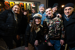 Brittney Olsen with friends from American Dreams Motorcycles at the Mr. Martini's Cafe and Restaurant party during Motor Bike Expo (MBE) bike show. Verona, Italy. Saturday, January 18, 2020. Photography ©2020 Michael Lichter.