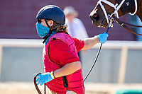 HOT SPRINGS, AR - MAY 02:  Outrider leads a horse into the starting gate during the Covid-19 Pandemic on Derby Day at Oaklawn Racing Casino Resort on May 2, 2020 in Hot Springs, Arkansas. (Photo by Wesley Hitt/Getty Images)