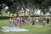 Israel, Preschool teacher with a group of preschool children in a park