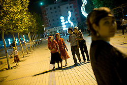 Uyghurs pass time in Hotan, Xinjian province in China.