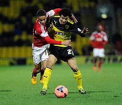 Watford's Iriney and Bristol City's Bobby Reid jostles for the ball - Photo mandatory by-line: Dougie Allward/JMP - Tel: Mobile: 07966 386802 14/01/2014 - SPORT - FOOTBALL - Vicarage Road - Watford - Watford v Bristol City - FA Cup - Third Round - replay